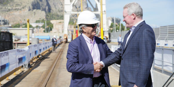 Executive Vice President of Fincantieri Services Giorgio Rizzo shaking hands with John Delaney
