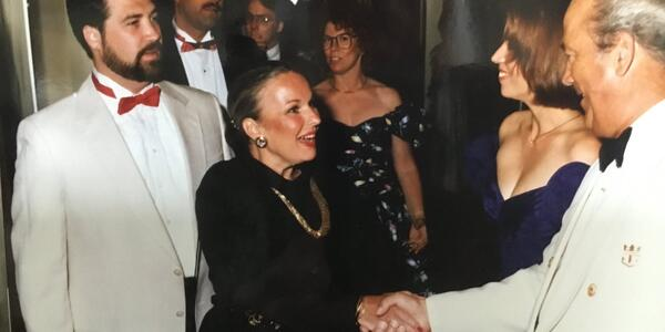 Old photo of Cruise Critic member cruiserone shaking hands with a crew member on Song of America in 1989