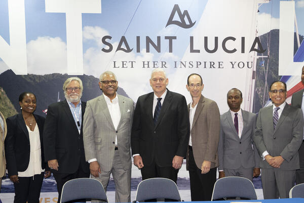Cruise executives including Mickey Arison, Arnold Donald, Adam Goldstien, etc posing with officials representing Saint Lucia (Photo: Carnival Corp.)