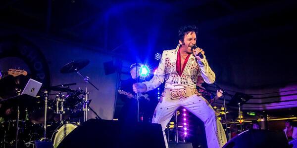 An Elvis impersonator performing onboard The Malt Shop Memories Cruise