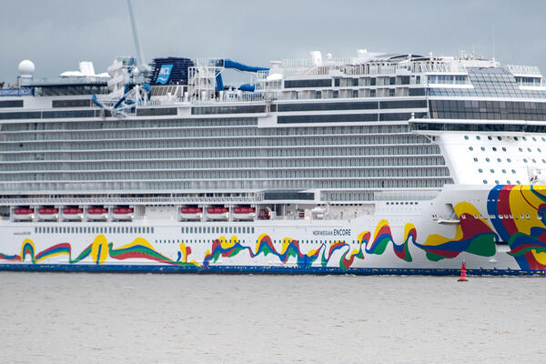 Exterior shot of Norwegian Encore being delivered to Norwegian Cruise Line on a cloudy day