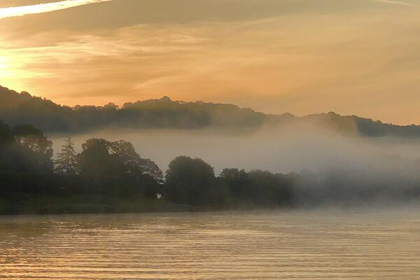 Foggy landscape of the Seine river, trees shrouded in mist line the riverbank (Photo: Viking River Cruises)