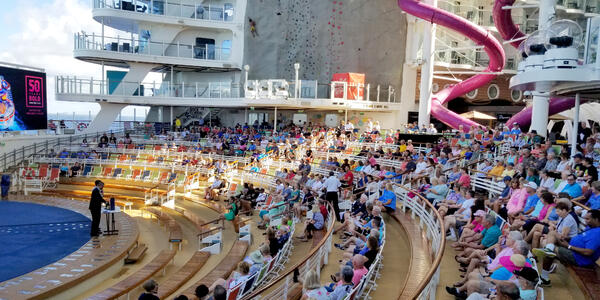Cruise Critic fans attend a Meet & Mingle on Symphony of the  Seas, hosted by the ship's cruise director (Photo: Colleen McDaniel/Cruise Critic)