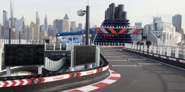 Shot of an empty race track onboard the Norwegian Encore cruise ship, with Manhattan skyline in the background