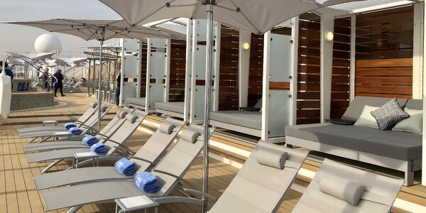 Shot of the Vibe sun deck loungers and cabanas on Norwegian Encore
