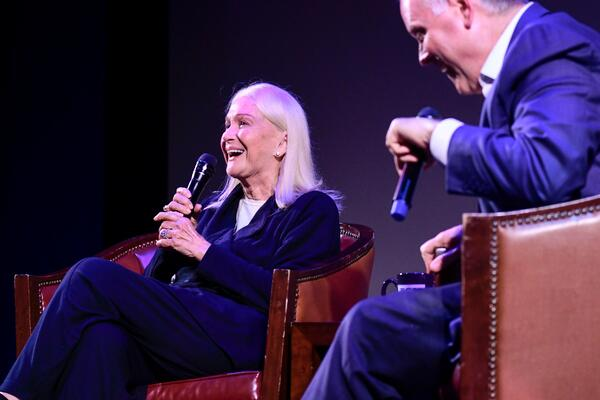 Shot of Diane Ladd smiling and speaking into a microphone onstage during the TCM Cruise