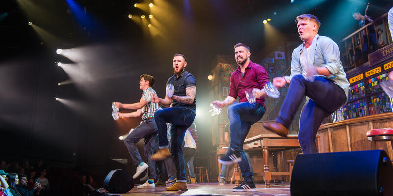 Four male performers dancing onstage for Choir of Man on Norwegian Encore (Photo: Cruise Critic)
