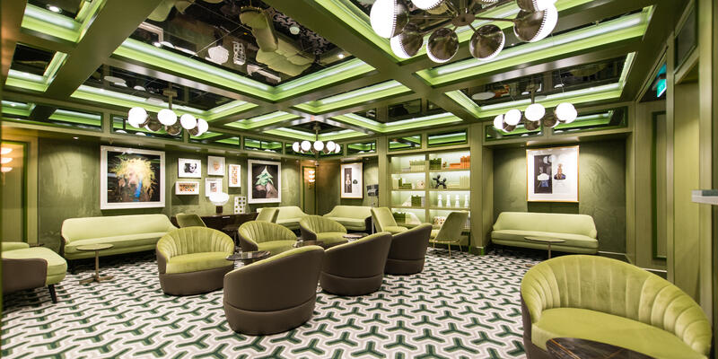 An entirely pale green room inside the Social Comedy & Nightclub on Norwegian Encore (Photo: Cruise Critic)