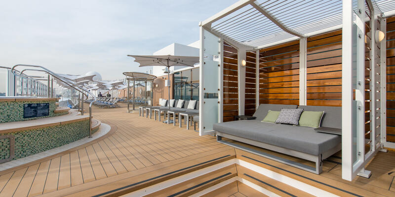 Shot of a daybed and several loungers at Vibe Beach Club during a sunny day, without passengers