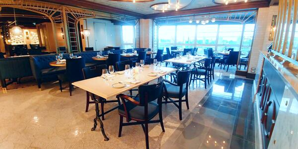 Wide-angle shot of La Mer tables on Sky Princess, without passengers