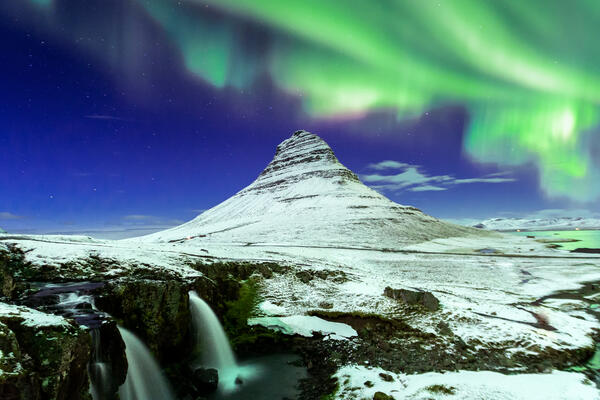 Aurora Borealis showcasing the Northern Lights above Kirkjufell Mountain in Iceland (Photo: basiczto/Shutterstock)