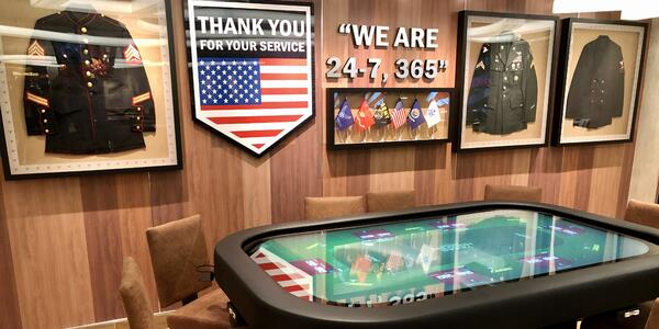 Shot of the interior decor of a veterans themed bar on Carnival Panorama