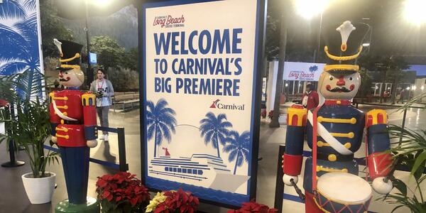 Carnival Panorama welcome sign, flanked by two life-size nutcrackers, at the Long Beach Cruise Terminal