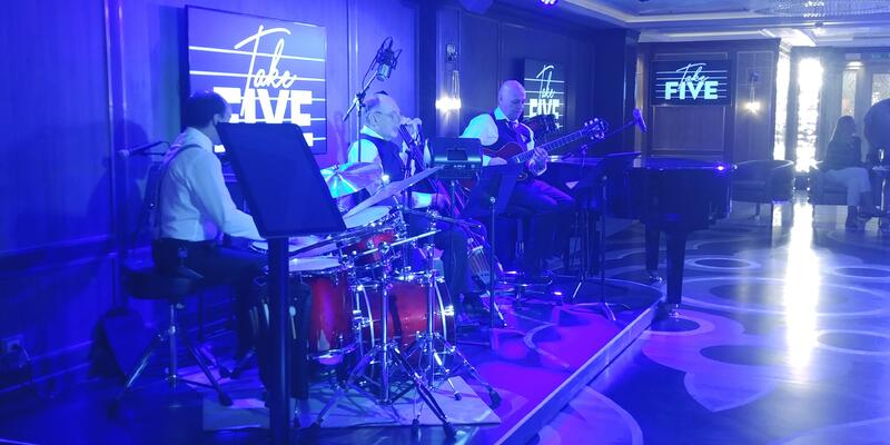The Take Five Lounge performance area at night, with performers onstage