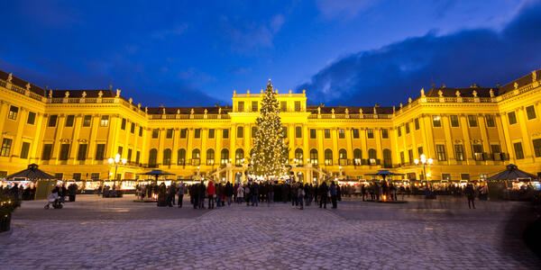Holiday shoppers at the Christmas Markets in the courtyard of the Schönbrunn Palace in Vienna, Austria (Photo: Shutterstock)