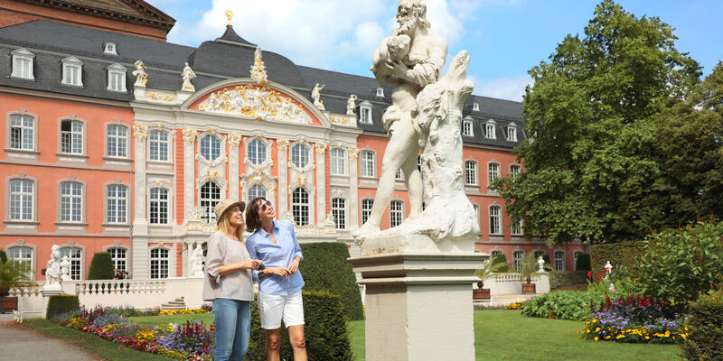 Two young female tourists exploring the grounds of the Electoral Palace in Trier, Germany (Photo: Michel Verdure Studio Inc)