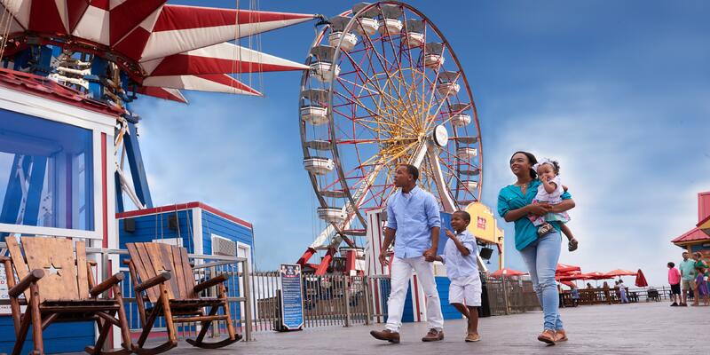 Young African-American family enjoying a clear summer day at Pleasure Pier in Galveston, Texas, USA (Photo: Galveston Island Convention & Visitors Bureau)