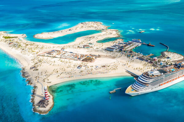 Aerial shot of the entire island of Ocean Cay MSC Marine Reserve, with a cruise ship docked in port
