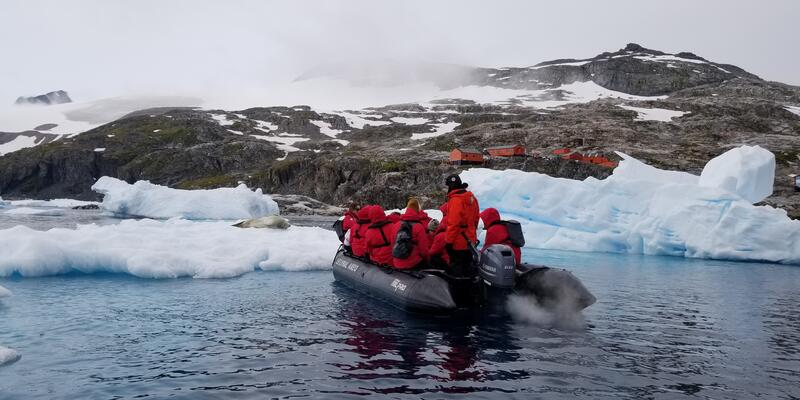 Group on a Zodiac excursion in Antarctica, approaching land