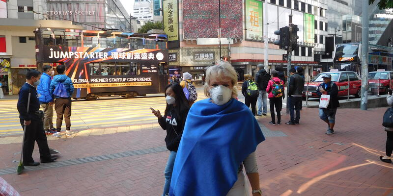 Sara Macefield dons a face mask in HK during the Coronavirus