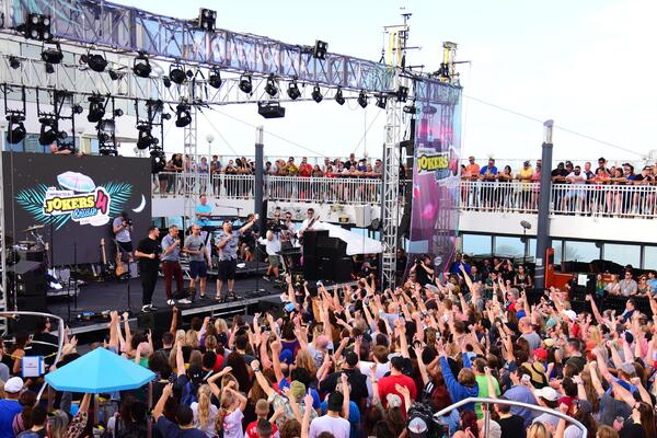 The four Impractical Jokers on the pool deck stage at Impractical Jokers Cruise 4