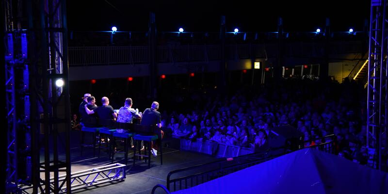 Shot of a night-time Q&A session with the Jokers on Impractical Jokers Cruise 4