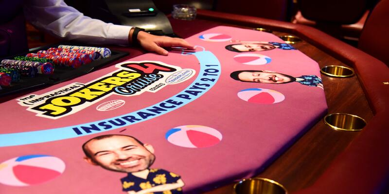 Close-up shot of a Jokers-themed poker table on Impractical Jokers Cruise 4