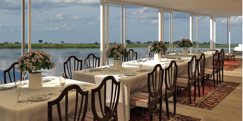 Interior of a restaurant on African Dream, with river views in the background