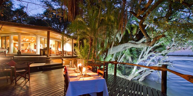 Exterior shot of al fresco dining space at night, at the luxury safari lodge in Namibia