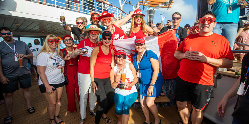 Passengers in matching Canadian outfits on the Ultimate Disco Cruise