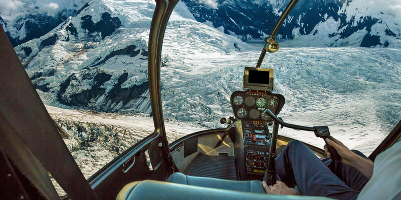 View of Denali from inside of a helicopter during a flightseeing tour in Alaska