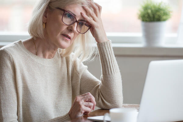 Frustrated worried senior middle aged female reading bad email news (Photo: fizkes/Shutterstock)