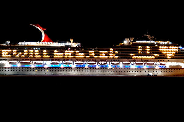 Carnival Freedom sending a message in lights that reads: 'We will be back :) <3' (Photo: Carnival Cruise Line)