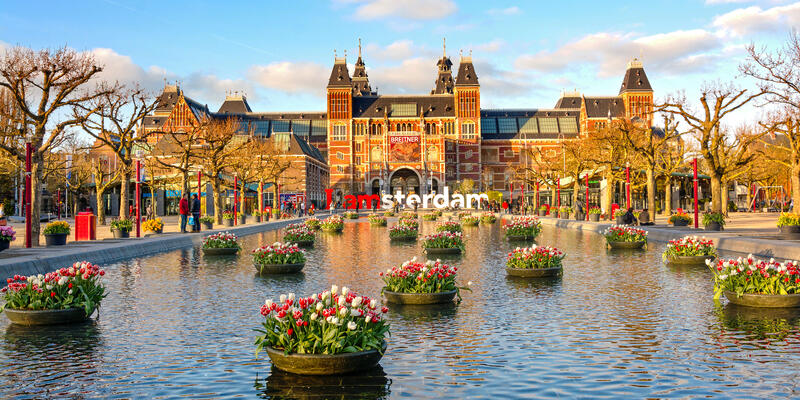 Exterior shot of The Rijksmuseum of Amsterdam in the spring golden hour