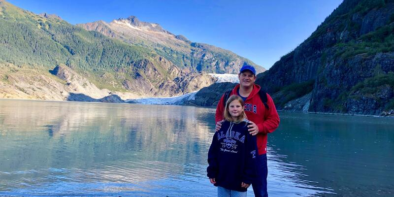 Mark Patscher posing for a photo with his daughter Ky in Alaska