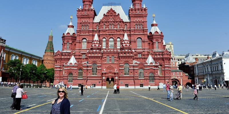 Chris Gray Faust posing in front of a building on a Russian waterways cruise shore excursion