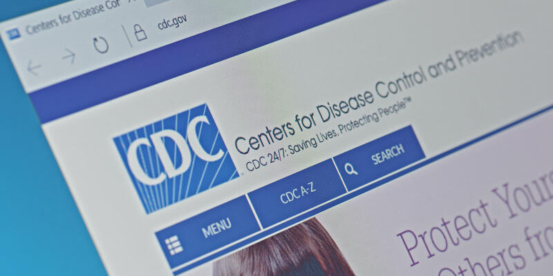 A computer screen shows details of Centers for Disease Control and Prevention main page on its web site. Selective focus.