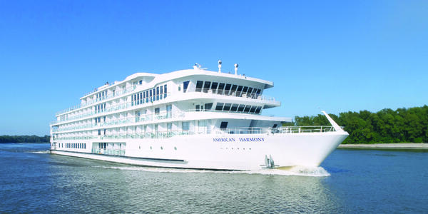 Exterior shot of American Harmony cruising along the river