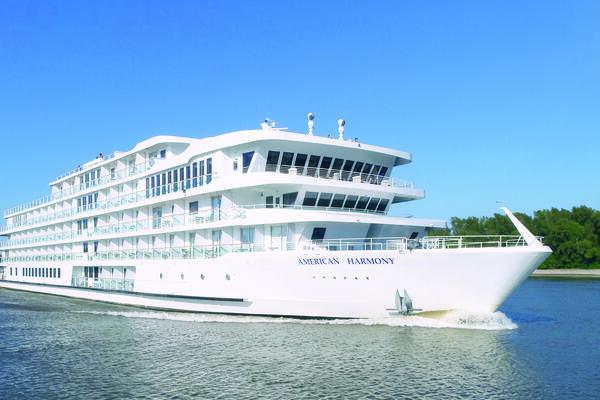 Exterior shot of American Harmony cruising along the river