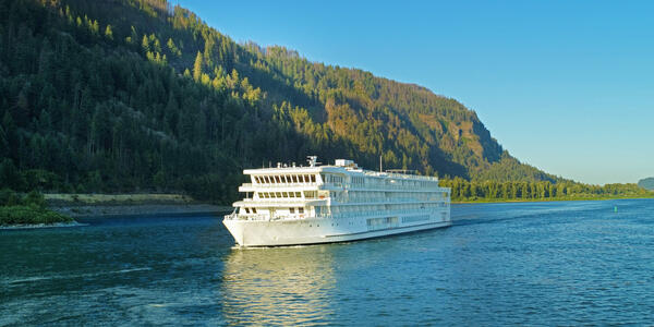 Exterior shot of American Song cruising the Columbia & Snake Rivers at sunset