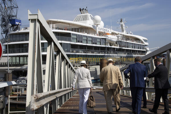 Exterior shot of Silver Origin during its June 3 handover, as executives walk onboard via the gangway