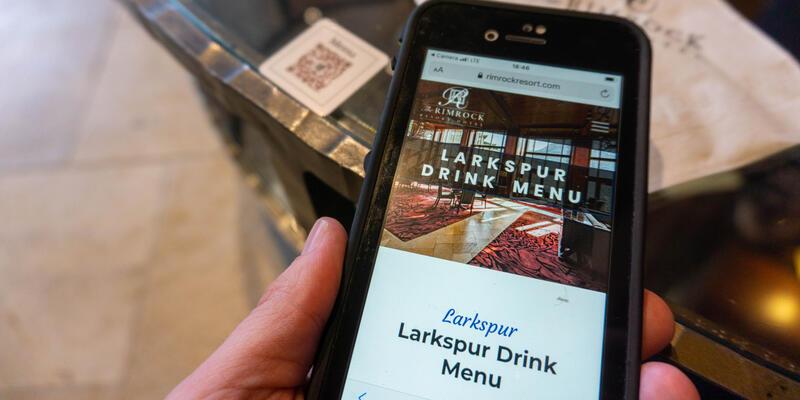 Close-up shot of the digital drink menu at The Rimrock Resort Hotel