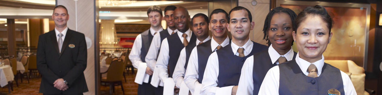 Dining room staff on Royal Caribbean's Allure of the Seas (Photo: Royal Caribbean International)