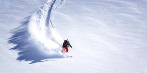 Skier Skiing Down Hill (Photo: MWiklik/Shutterstock)