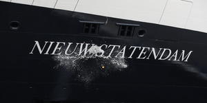 Champagne bottle smashing against the hull of Nieuw Statendam (Photo: Holland America Line)