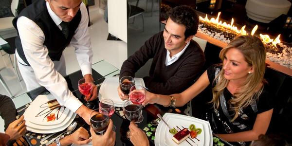 Friends Enjoying Fancy Dinner (Photo: ESB Professional/Shutterstock)