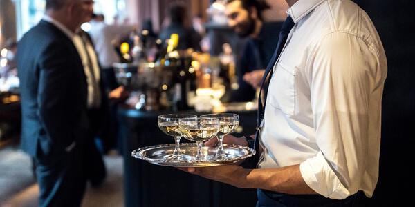 Waiter Catering Champagne for Event (Photo: Nick Starichenko/Shutterstock)