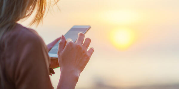 Be mindful of your mobile phone usage while at sea (Photo: tolotola/Shutterstock)