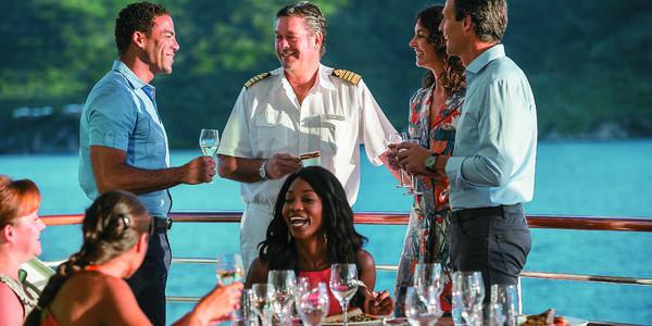 Dining with the captain on a Paul Gauguin cruise (Photo: Paul Gauguin Cruises)
