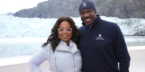 Oprah with President Orlando Ashford in Glacier Bay on board Eurodam (Photo: Holland America)